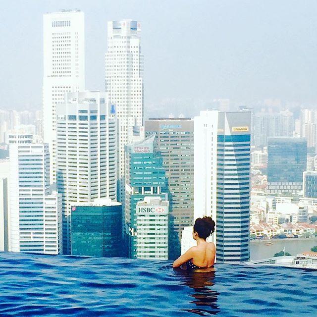 Woman enjoying a weekened getaway in Singapore in the pool